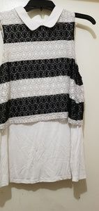 Black and white knit crop over longer white blouse